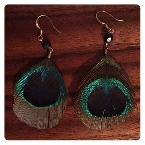 Peacock feather earrings never worn